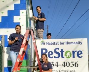 Volunteers painting the ReStore