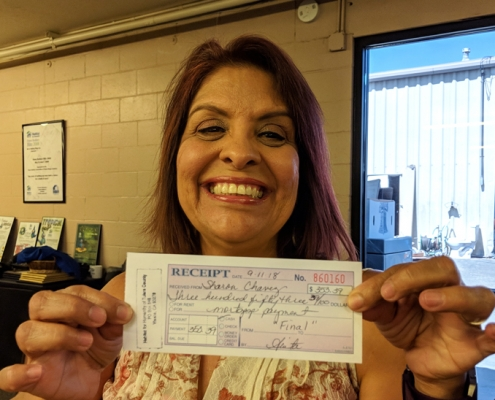 Sharon Chavez with last mortgage payment for Habitat